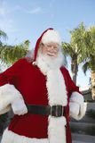 Santa Claus Standing With Hands On Hip. Portrait of happy Santa Claus standing with hands on hip Royalty Free Stock Photos