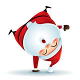 Santa Claus standing on his arm. Upside down. Royalty Free Stock Image