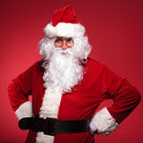 Santa claus is standing with his hands on hips Stock Photos