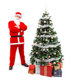 Santa Claus standing near Christmas tree Stock Photos