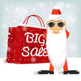 Santa Claus standing near a red big sale shopping bag Royalty Free Stock Photos