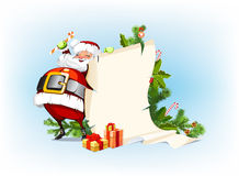 Santa Claus standing beside the scroll Stock Photography