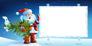 Santa Claus standing in the snow with a bag of Stock Images