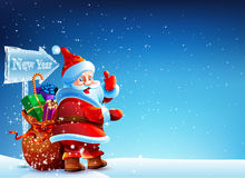 Santa Claus standing in the snow with a bag of gifts. And showing thumb up. Santa flying around the snowflakes. He stands against a dark blue sky with stars Royalty Free Stock Photos