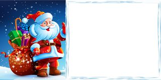 Santa Claus standing in the snow with a bag of gifts. And showing thumb up. Santa flying around the snowflakes. He stands against a dark blue sky with stars Stock Photos