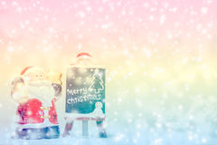 Santa Claus standing in the snow fake with a blackboard Stock Photography