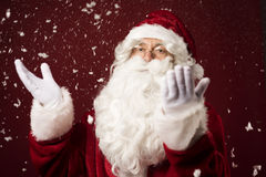 Santa Claus. Standing in the snowy scenery Royalty Free Stock Images