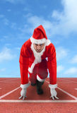 Santa Claus in the starting position on a running track royalty free stock images