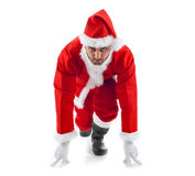 Santa Claus in the starting position on white background Royalty Free Stock Photo