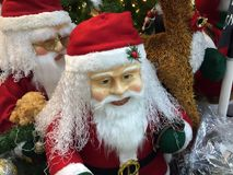 Santa Claus statue with Christmas decoration. Santa to bring presents for children. He is conventionally pictured as a jolly old man with a long white beard Royalty Free Stock Photos