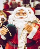 Santa Claus statue holding presents Stock Image