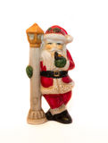 Santa Claus Statue på nordpolenkors, vit bakgrund Royaltyfria Bilder