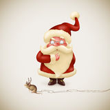 Santa Claus with a strange little reindeer Stock Images