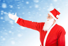 Santa Claus stretch his Hand Royalty Free Stock Photo