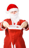 Santa Claus stretching hat Stock Photography