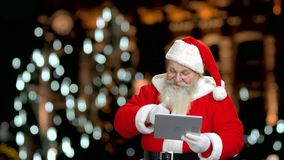 Santa Claus is stroking his beard. stock video footage