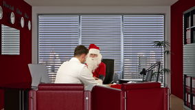 Santa Claus is strong and healthy, Doctor measuring blood pressure, stock footage Royalty Free Stock Images