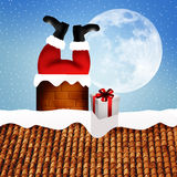 Santa Claus stuck in the chimney Stock Photography