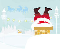 Santa Claus stuck in the chimney Royalty Free Stock Photo