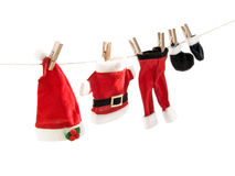 Santa Claus suit hanging on clothesline. Stock Photo