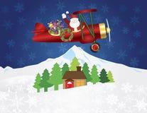 Santa Claus sul biplano con i presente sulla neve di notte Immagini Stock