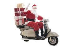Santa Claus sul motorino d'annata immagine stock
