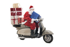 Santa Claus sul motorino d'annata fotografia stock libera da diritti