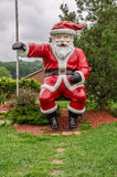 Santa Claus in Summer. It looks like Santa Claus might be missing an elf...about this high... Have you seen him stock photography