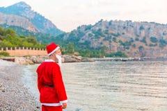 Santa Claus in the summer. Sea stock photos