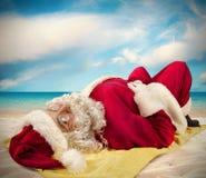 Santa claus sunbathing Royalty Free Stock Photos
