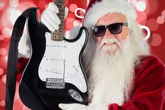 Santa claus in sunglasses holding guitar Stock Photo