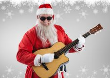 Santa claus in sunglasses playing guitar Royalty Free Stock Images