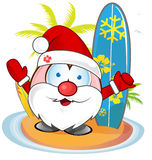 Santa claus with surfboard Royalty Free Stock Photography