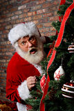 Santa Claus Surprised by the Christmas Tree Royalty Free Stock Images
