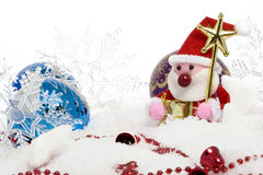 Santa claus surrounded by christmas balls on snow Stock Photography