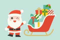Santa Claus sveglia con il mucchio dei contenitori di regalo sulla slitta di Natale Fotografia Stock