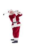 Santa Claus swings his golf club