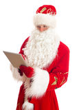 Santa Claus with tablet pc. Royalty Free Stock Image