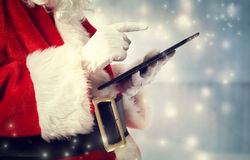 Santa Claus with tablet royalty free stock photography
