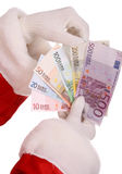 Santa claus take group of money. Group of money in hand of santa claus Royalty Free Stock Images