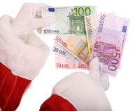 Santa claus take group of money. Group of money in hand of santa claus Stock Image