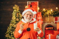 Santa Claus takes a cookie on Christmas Eve as a thank you gift for leaving presents. Cookies for Santa Claus.