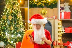 Santa Claus takes a cookie on Christmas Eve as a thank you gift for leaving presents. Christmas food and drink