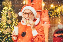 Santa Claus takes a cookie on Christmas Eve as a thank you gift for leaving presents. Happy new year. Merry Christmas