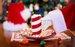 Santa Claus taking cup of hot chocolate Royalty Free Stock Photos