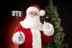 Santa Claus taking selfie Stock Images