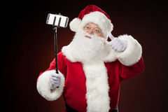 Santa Claus taking selfie Royalty Free Stock Images