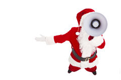Santa Claus talking with megaphone Stock Images