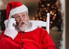 Santa claus talking on mobile phone Royalty Free Stock Images