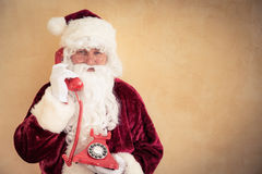 Santa Claus talking on phone Royalty Free Stock Photo